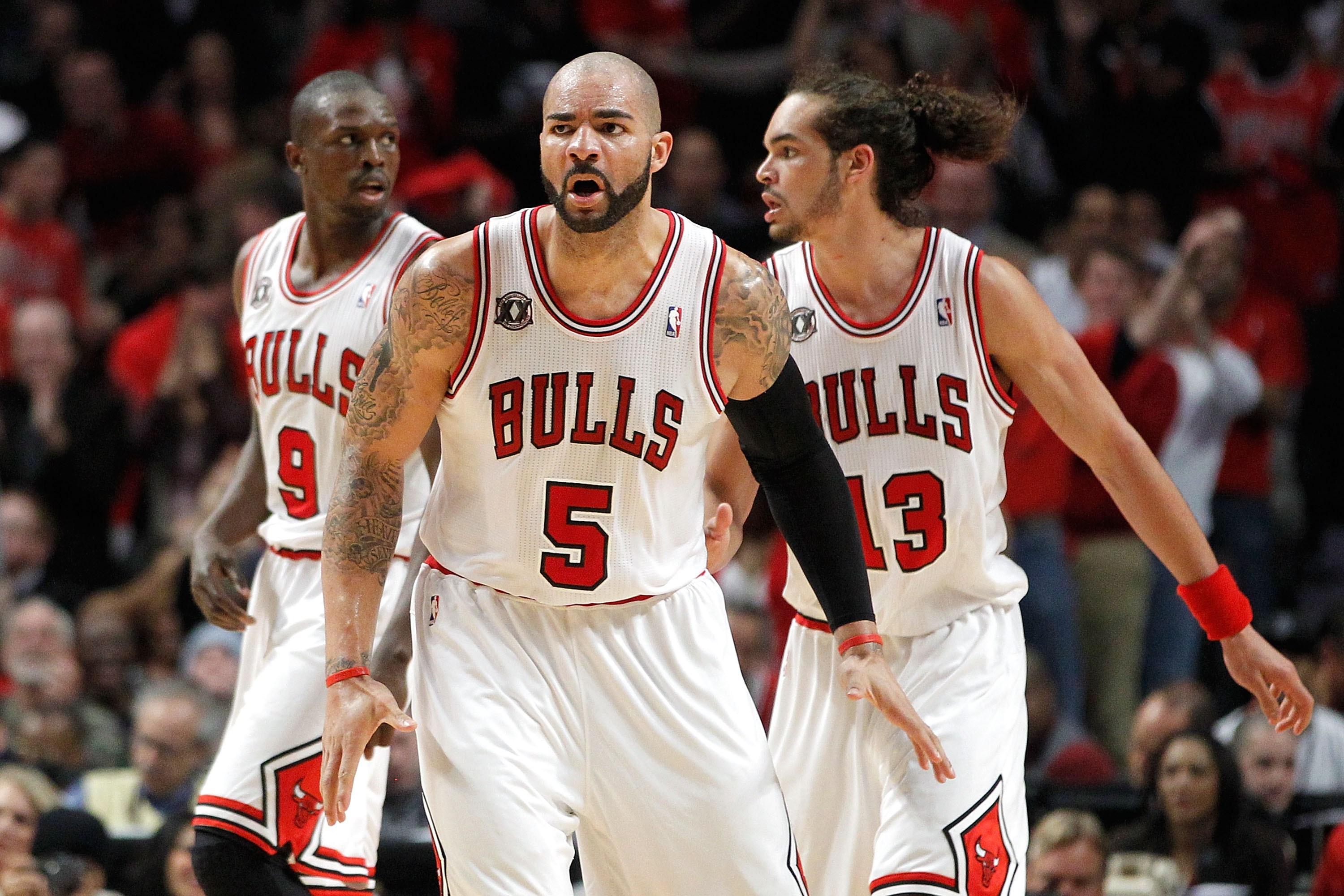 CHICAGO, IL - MAY 15:  (L-R) Luol Deng #9, Carlos Boozer #5 and Joakim Noah #13 of the Chicago Bulls get back on defense against the Miami Heat in Game One of the Eastern Conference Finals during the 2011 NBA Playoffs on May 15, 2011 at the United Center