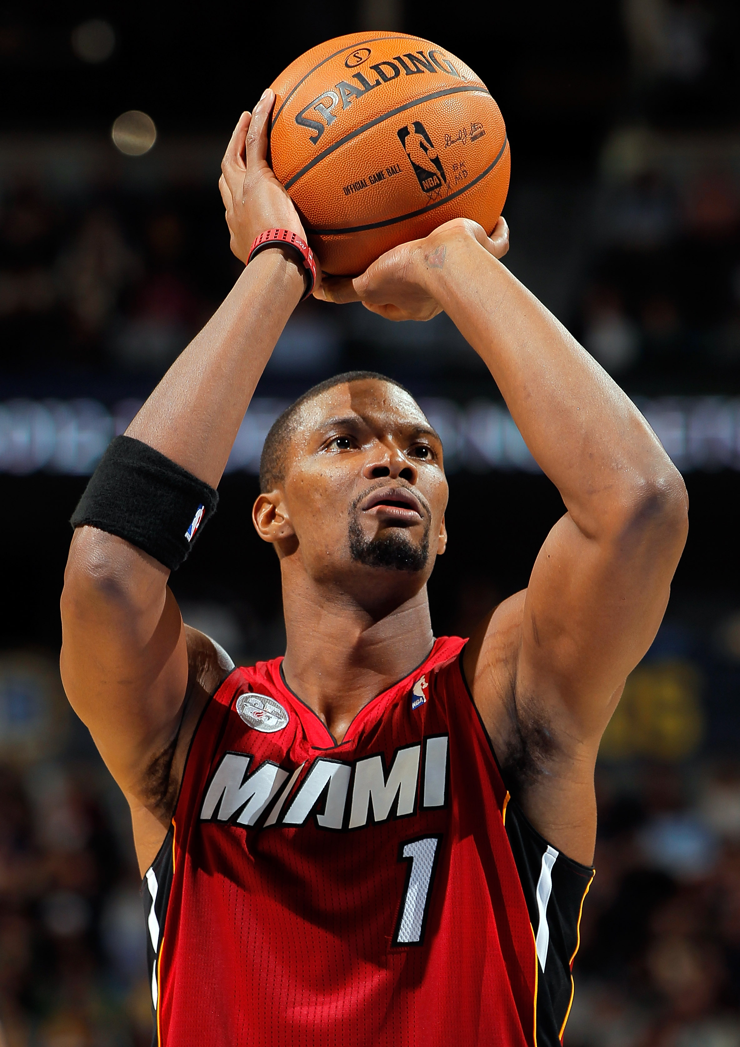 DENVER, CO - NOVEMBER 15:  Chris Bosh #1 of the Miami Heat takes a shot against the Denver Nuggets at the Pepsi Center on November 15, 2012 in Denver, Colorado. The Heat defeated the Nuggets 98-93. NOTE TO USER: User expressly acknowledges and agrees that