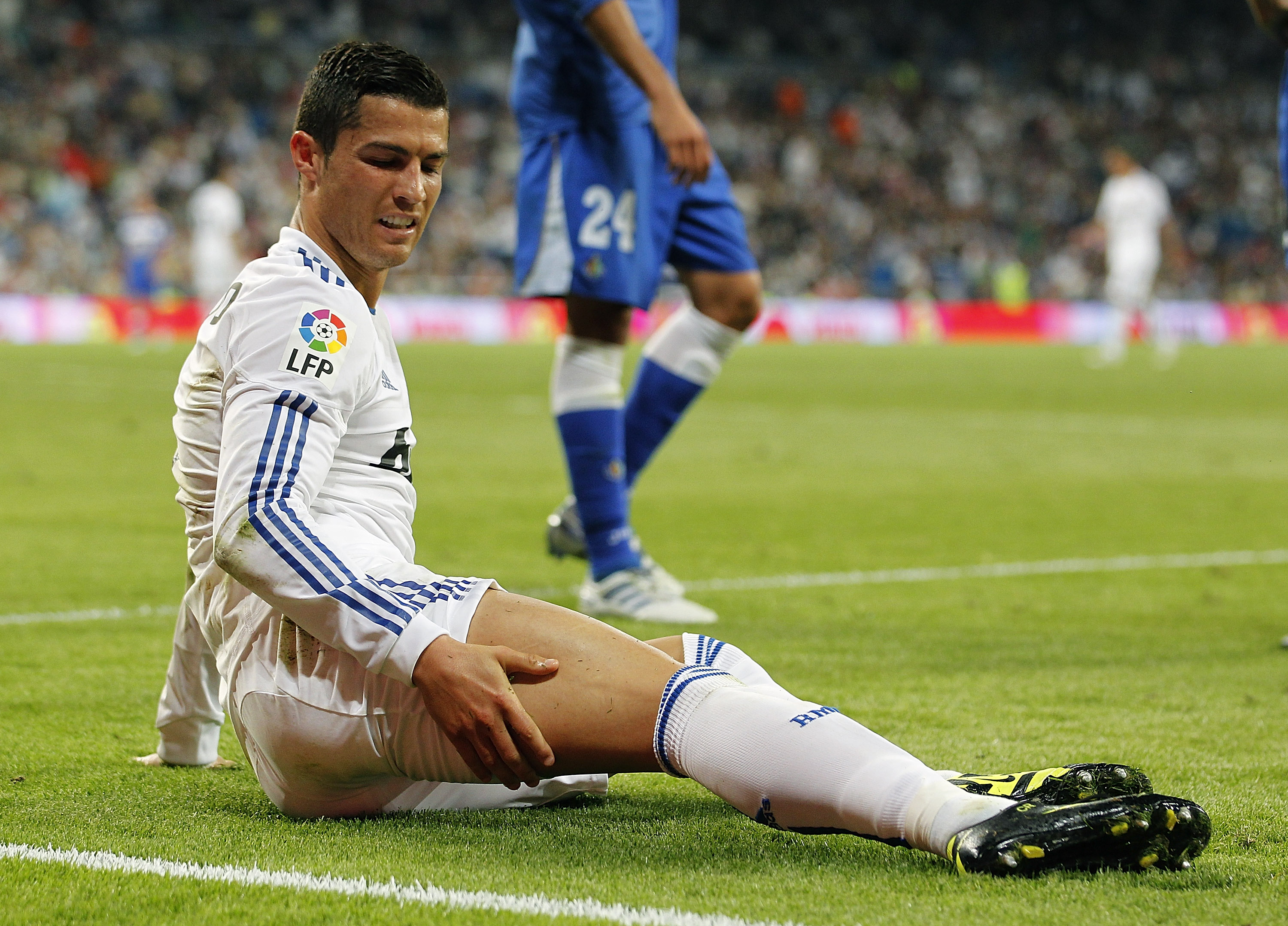 MADRID, SPAIN - MAY 10:  Cristiano Ronaldo of Real Madrid grimaces during the La Liga match between Real Madrid and Getafe at Estadio Santiago Bernabeu on May 10, 2011 in Madrid, Spain.  (Photo by Angel Martinez/Getty Images)