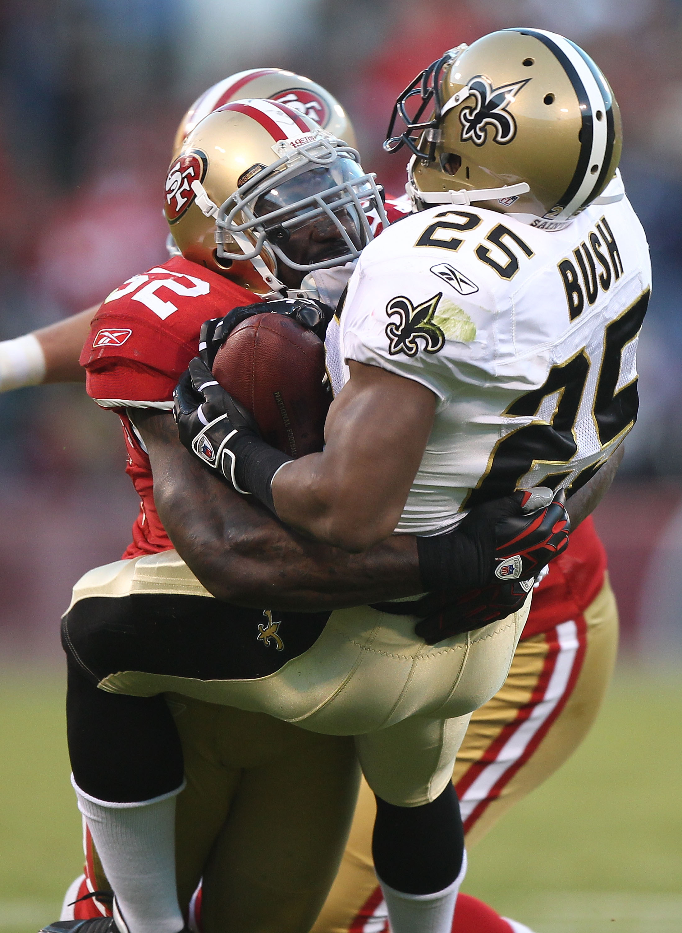 SAN FRANCISCO - SEPTEMBER 20:  Patrick Willis #52 of the San Francisco 49er tackles Reggie Bush #25 of the New Orleans Saints during an NFL game at Candlestick Park on September 20, 2010 in San Francisco, California.(Photo by Jed Jacobsohn/Getty Images)