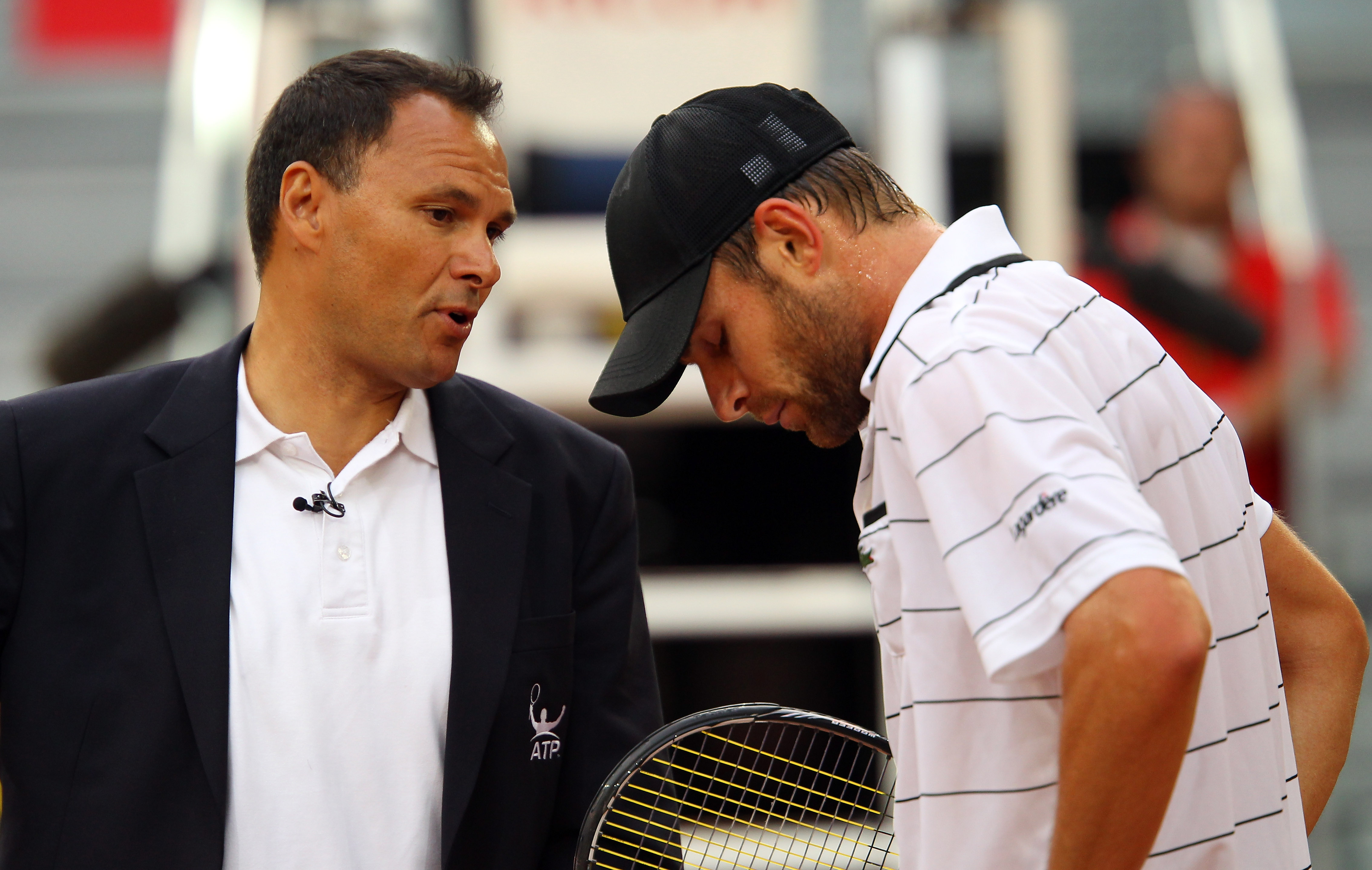 MADRID, SPAIN - MAY 02:  Andy Roddick of USA disscusses a line call with umpire Mohamed Lahyani in his match against Flavio Cipolla of Italy during day three of the Mutua Madrilena Madrid Open Tennis on May 2, 2011 in Madrid, Spain.  (Photo by Julian Finn