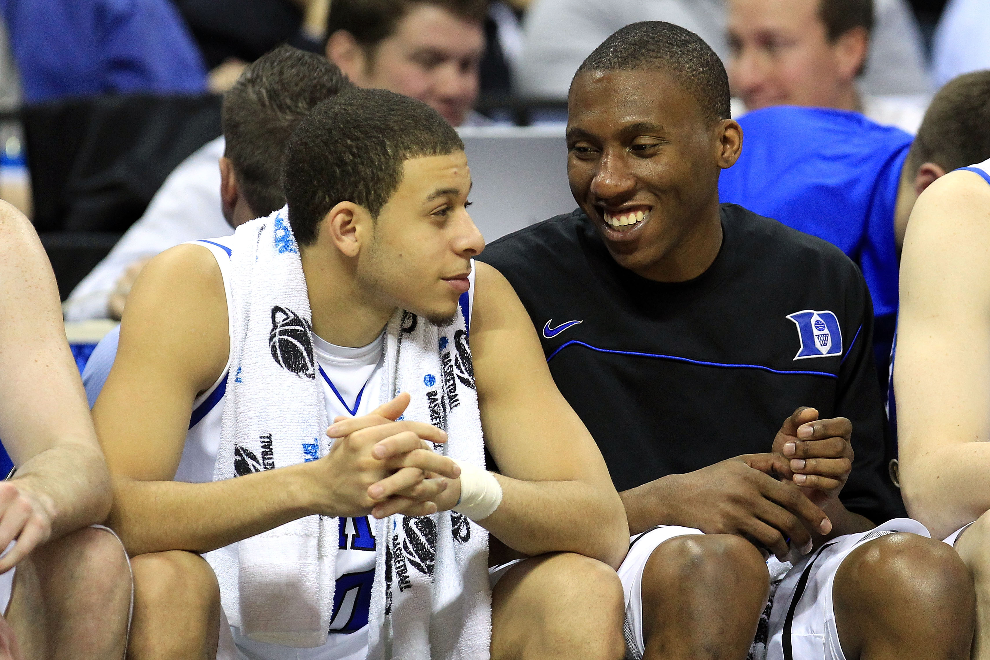 CHARLOTTE, NC - MARCH 18:  Seth Curry #30 and Nolan Smith #2 of the Duke Blue Devils talk on the bench late in the second half against the Hampton Pirates during the second round of the 2011 NCAA men's basketball tournament at Time Warner Cable Arena on M