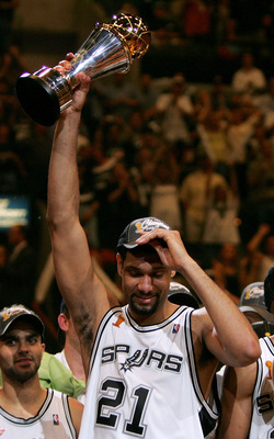 SAN ANTONIO - JUNE 23:  Finals MVP Tim Duncan #21 of the San Antonio Spurs holds up the MVP trophy after the Spurs defeated the Detroit Pistons in Game seven of the 2005 NBA Finals at SBC Center on June 23, 2005 in San Antonio, Texas.  The Spurs defeated