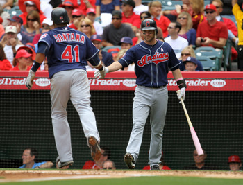 ANAHEIM, CA - MAY 8: Carlos Santana #41 of the Cleveland Indians is greeted by on deck hitter Adam Everett #8 as he scores in the second inning against the Los Angeles Angels of Anaheim on May 8, 2011 at Angel Stadium in Anaheim, California.  (Photo by St