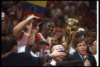 14 Jun 1995:  Center Hakeen Olajuwon of the Houston Rockets celebrates after a Finals game against the Orlando Magic at The Summit in Houston, Texas.  The Rockets won the game, 113-101. Mandatory Credit: Allsport  /Allsport Mandatory Credit: Allsport  /Al