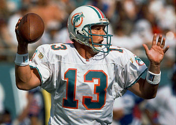 MIAMI - 1986:  Quarterback Dan Marino #13 of the Miami Dolphins smiles as he holds the ball during a game against the Atlanta Falcons in 1986 at Pro Player Stadium in Miami, Florida.  Falcons won 20-14.  (Photo by Bob Martin/Getty Images)