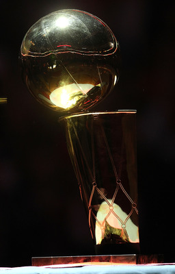 CHICAGO, IL - MARCH 12: The Chicago Bulls Championship trophy is on display during a 20th anniversary recognition ceremony of the 1st NBA Championship in 1991 during half-time of a game bewteen the Bulls and the Utah Jazz at the United Center on March 12,