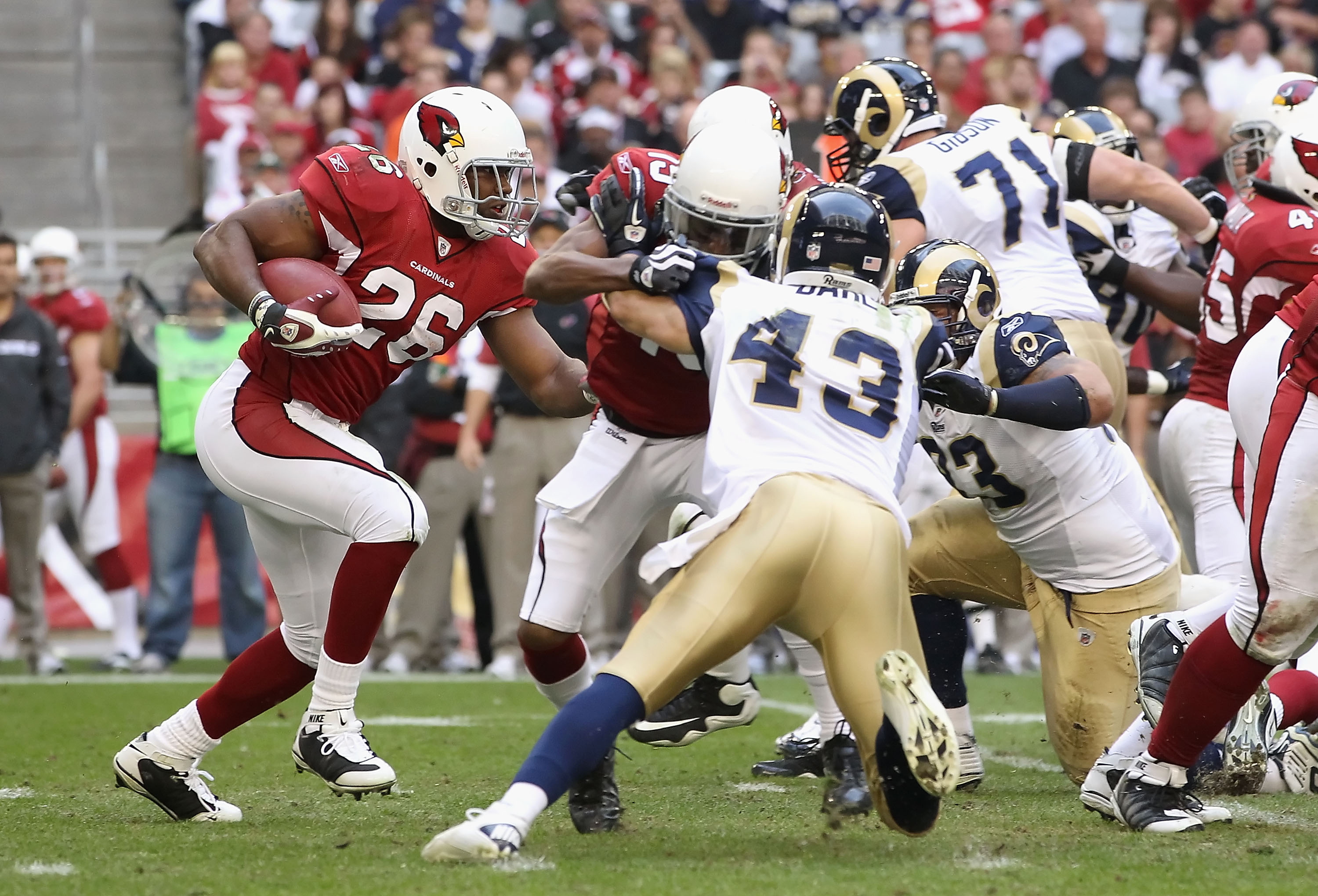 GLENDALE, AZ - DECEMBER 05:  Runningback Beanie Wells #26 of the Arizona Cardinals rushes the football during the NFL game against the St. Louis Rams at the University of Phoenix Stadium on December 5, 2010 in Glendale, Arizona.  The Rams defeated the Car