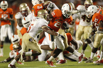 MIAMI, FL - OCTOBER 9: Damien Berry #20 of the Miami Hurricanes breaks the tackle of Greg Reid #5 of the Florida State Seminoles to score a touchdown in the third quarter on October 9, 2010 at Sun Life Stadium in Miami, Florida. The Seminoles defeated the