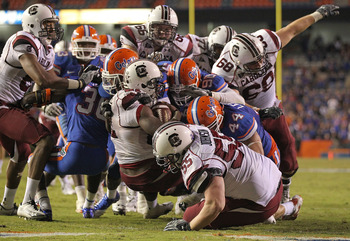 GAINESVILLE, FL - NOVEMBER 13:  Marcus Lattimore #21 of the South Carolina Gamecocks rushes for a touchdown during a game against the Florida Gators at Ben Hill Griffin Stadium on November 13, 2010 in Gainesville, Florida.  (Photo by Mike Ehrmann/Getty Im
