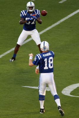 MIAMI GARDENS, FL - FEBRUARY 07:  Quarterback Peyton Manning #18 and wide receiver  Reggie Wayne #87 of the Indianapolis Colts warm up prior to Super Bowl XLIV against the New Orleans Saints on February 7, 2010 at Sun Life Stadium in Miami Gardens, Florid