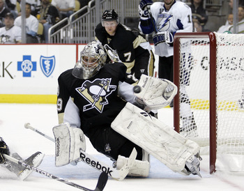 PITTSBURGH, PA - APRIL 27:  Marc-Andre Fleury #29 of the Pittsburgh Penguins makes a glove save during a power play against the Tampa Bay Lightning in Game Seven of the Eastern Conference Quarterfinals during the 2011 NHL Stanley Cup Playoffs at Consol En