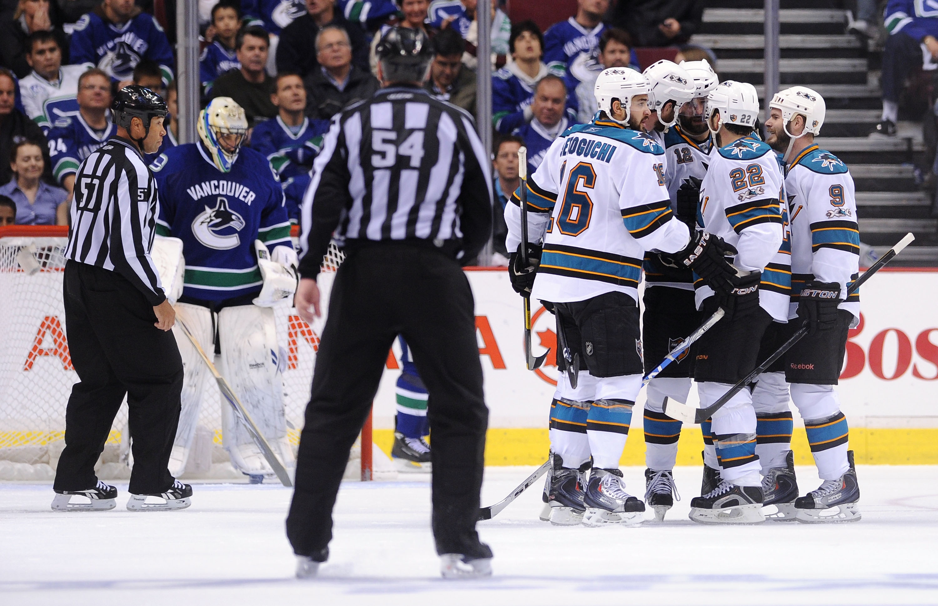 VANCOUVER, BC - MAY 15:  Patrick Marleau #12 of the San Jose Sharks celebrates his second period goal with teammates Devin Setoguchi #16, Joe Thornton #19, Dan Boyle #22 and Ian White #9 as goaltender Roberto Luongo #1 of the Vancouver Canucks looks on in