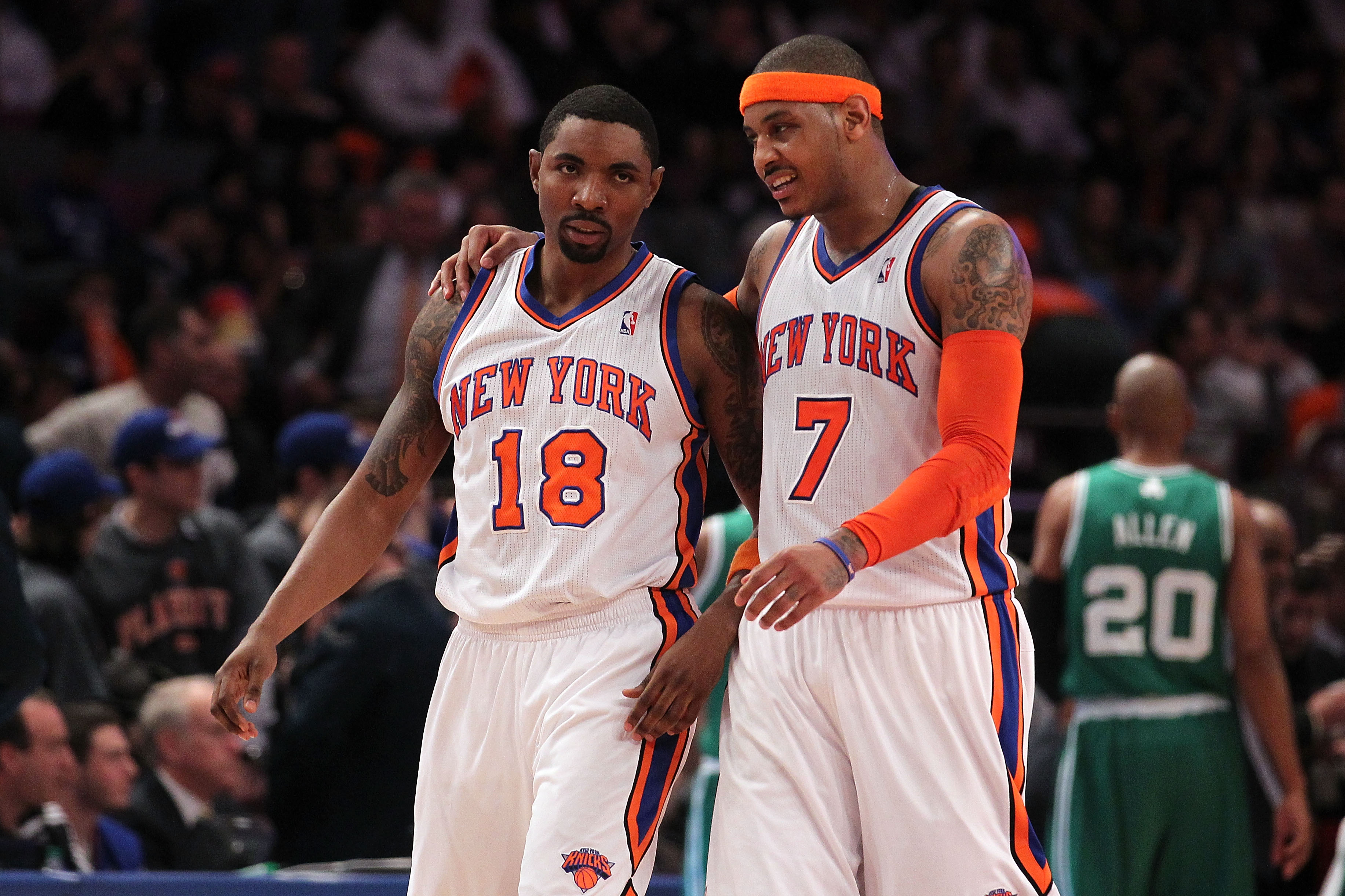 NEW YORK, NY - APRIL 22:  (L-R) Roger Mason #18 and Carmelo Anthony #7 of the New York Knicks talk as they walk up court against the Boston Celtics in Game Three of the Eastern Conference Quarterfinals in the 2011 NBA Playoffs on April 22, 2011 at Madison