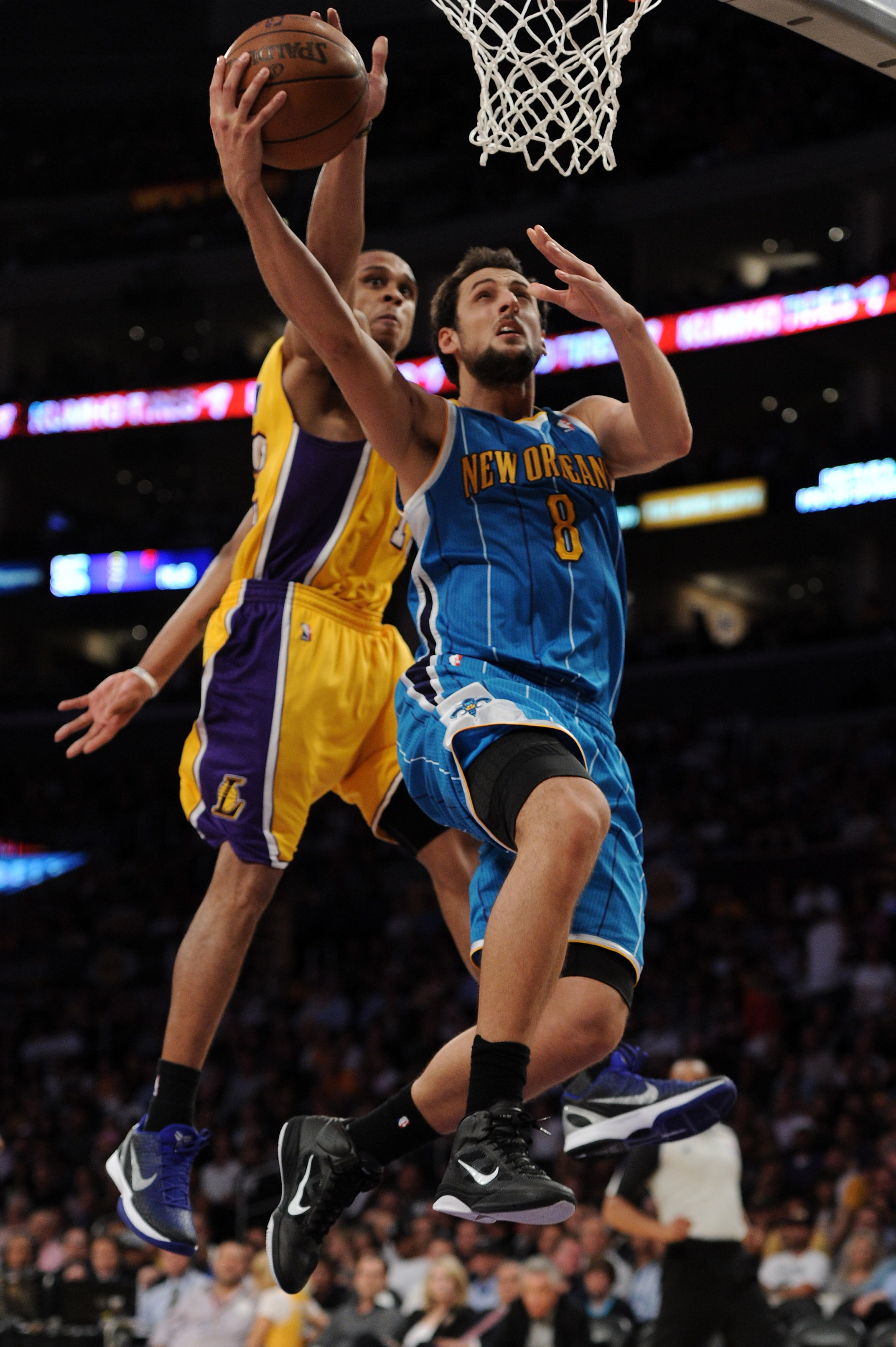 LOS ANGELES, CA - APRIL 26:  Marco Belinelli #8 of the New Orleans Hornets goes up for a layup in front of Shannon Brown #12 of the Los Angeles Lakers in the second half in Game Five of the Western Conference Quarterfinals in the 2011 NBA Playoffs on Apri