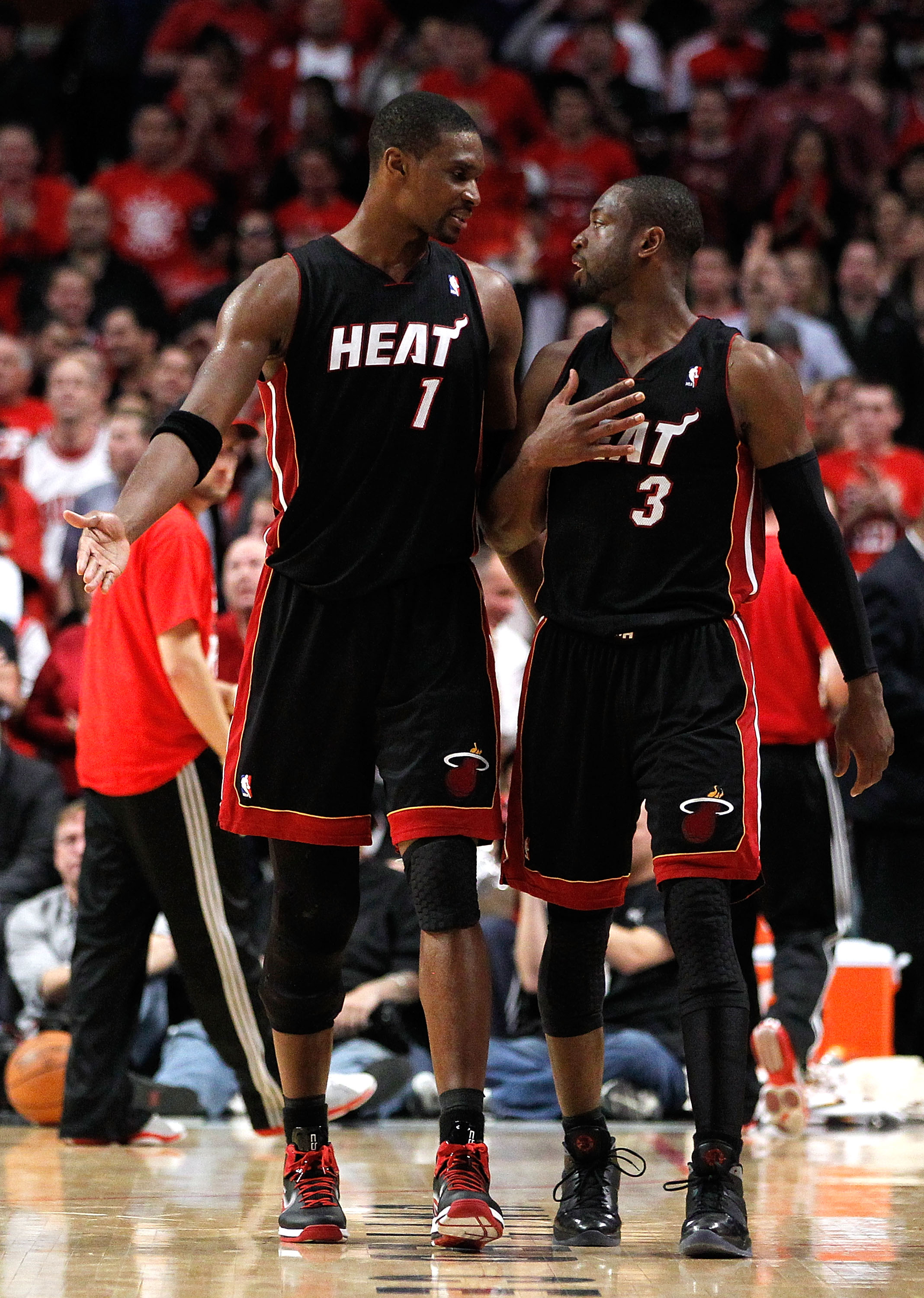 CHICAGO, IL - MAY 15: (L-R) Chris Bosh #1 and Dwyane Wade #3 of the Miami Heat talk on court against the Miami Heat in Game One of the Eastern Conference Finals during the 2011 NBA Playoffs on May 15, 2011 at the United Center in Chicago, Illinois. NOTE T