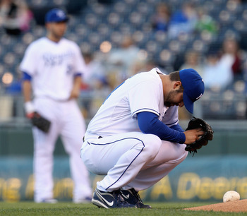 KANSAS CITY, MO - MAY 16: Starting pitcher Kyle Davies #34 of the Kansas City Royals prays just prior to the start of the game against the Cleveland Indians on May 16, 2011 at Kauffman Stadium in Kansas City, Missouri.  Davies left the game due to injury