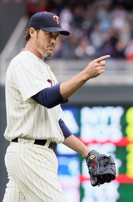 MINNEAPOLIS, MN - APRIL 08:  Joe Nathan #36 of the Minnesota Twins celebrates the win over the Oakland Athletics during Opening Day on April 8, 2011 at Target Field in Minneapolis, Minnesota. The Minnesota Twins defeated the Oakland Athletics 2-1.  (Photo