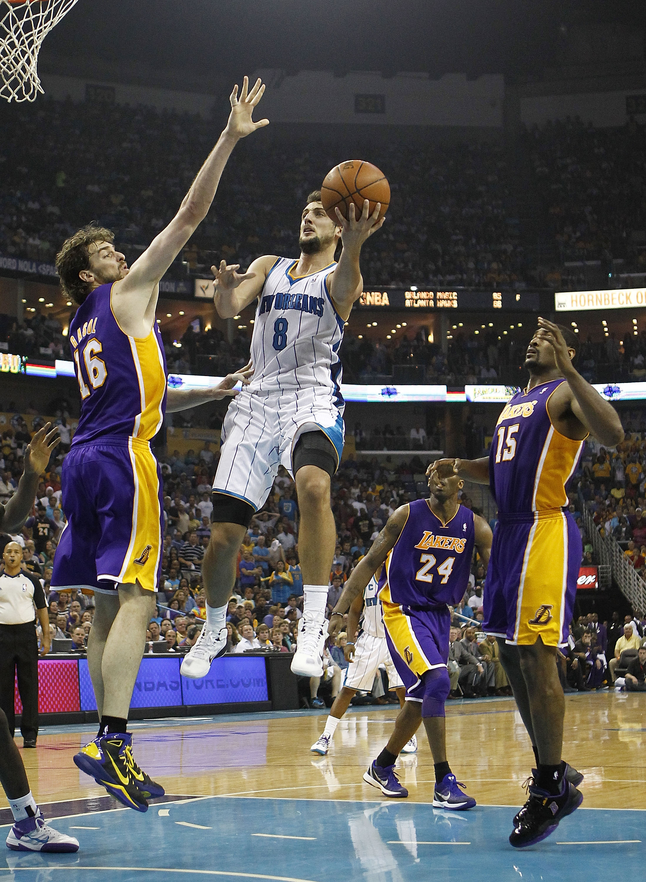 NEW ORLEANS - APRIL 24:  Marco Belinelli #8 of the New Orleans Hornets shoots over Pau Gasol #16 of the Los Angeles Lakers in Game Four of the Western Conference Quarterfinals in the 2011 NBA Playoffs at New Orleans Arena on April 24, 2011 in New Orleans,