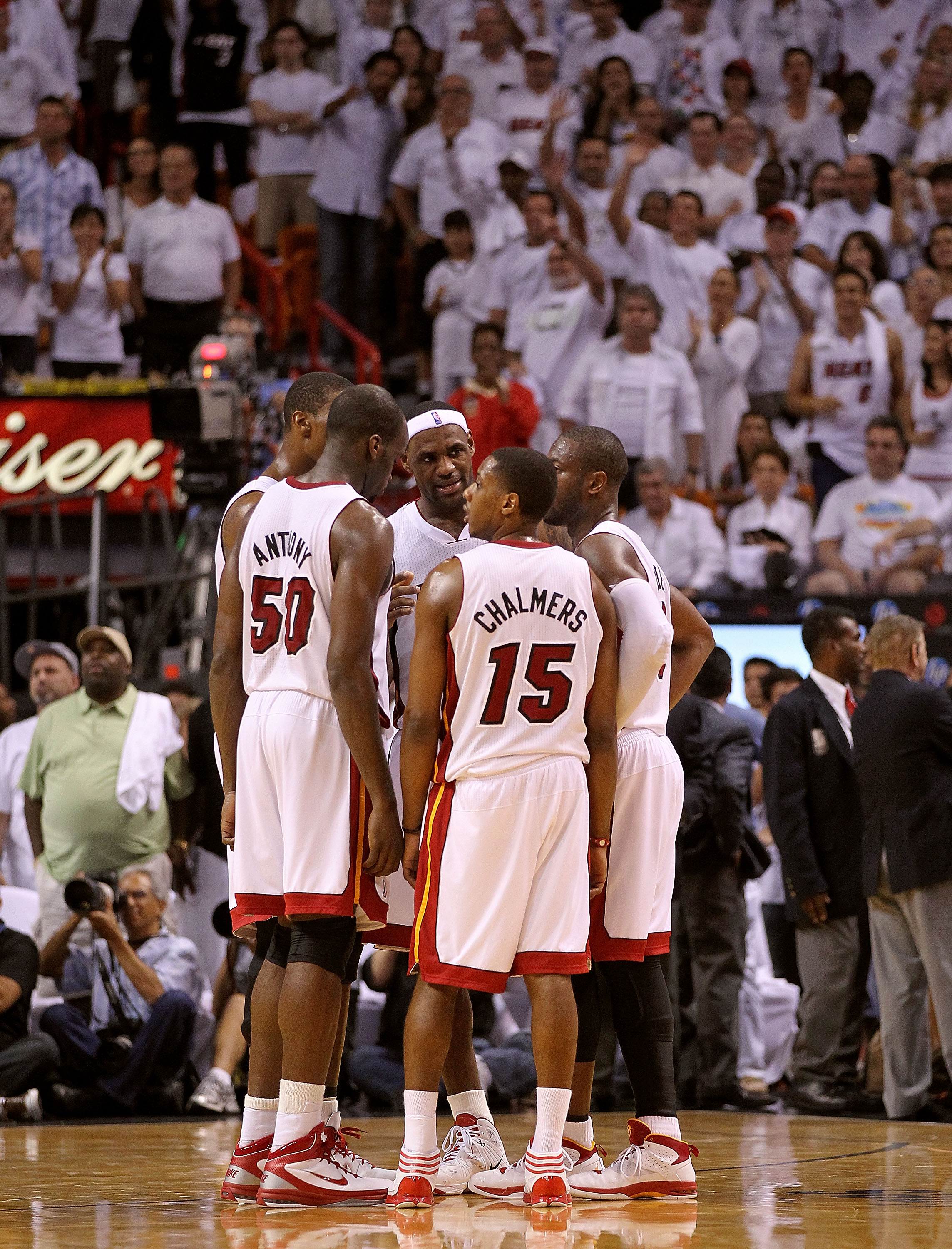 MIAMI, FL - MAY 01:  LeBron James #6, Dwyane Wade #2, Chris Bosh #1, Mario Chalmers #15, and Joel Anthony #50 of the Miami Heat talk during Game One of the Eastern Conference Semifinals of the 2011 NBA Playoffs against the Boston Celtics at American Airli