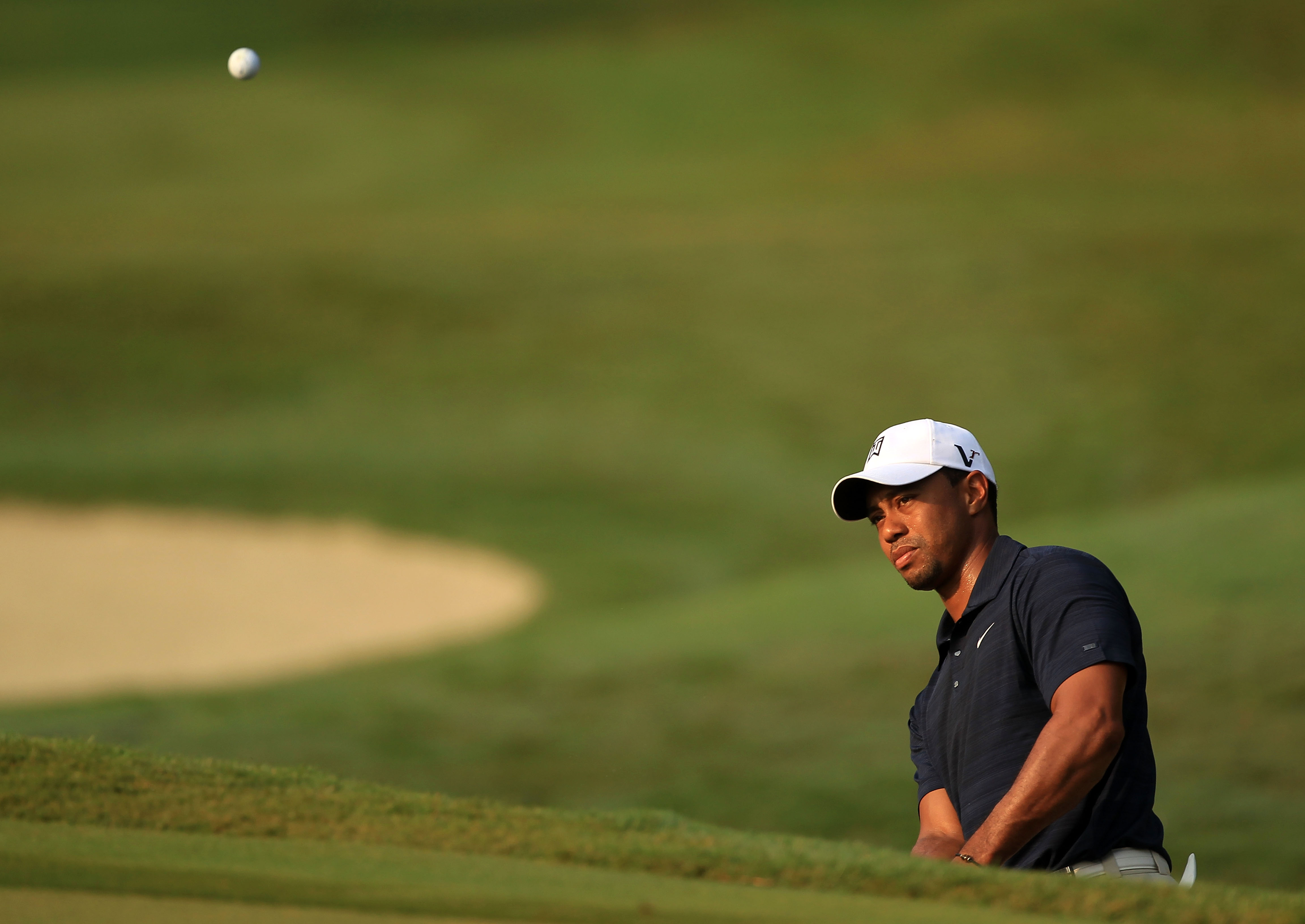 PONTE VEDRA BEACH, FL - MAY 12:  Tiger Woods hits a chip shot on the first hole during the first round of THE PLAYERS Championship held at THE PLAYERS Stadium course at TPC Sawgrass on May 12, 2011 in Ponte Vedra Beach, Florida.  (Photo by Streeter Lecka/