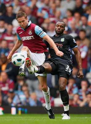 LONDON, ENGLAND - APRIL 16:  Matthew Upson of West Ham United and Darren Bent of Aston Villa battle for the ball during the Barclays Premier League match between West Ham United and Aston Villa at the Boleyn Ground on April 16, 2011 in London, England.  (