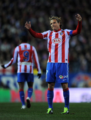 MADRID, SPAIN - JANUARY 20:  Diego Forlan of Atletico Madrid reacts during the quarter-final Copa del Rey second leg match between Atletico Madrid and Real Madrid and at Vicente Calderon Stadium on January 20, 2011 in Madrid, Spain.  (Photo by Jasper Juin