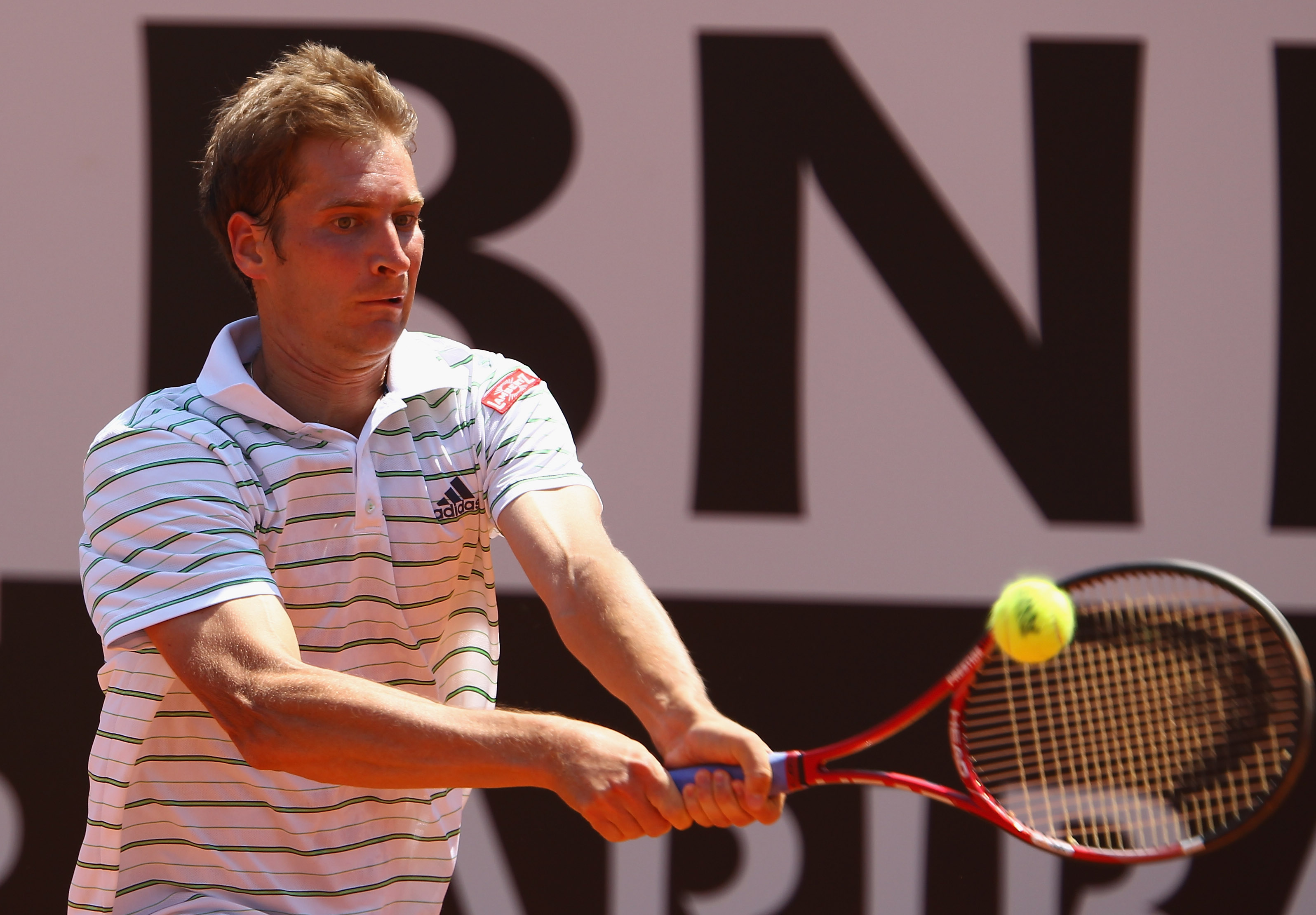 ROME, ITALY - MAY 13:  Florian Mayer of Germany plays a backhand during his quarter final match against Andy Murray of Great Britain during day six of the Internazoinali BNL D'Italia at the Foro Italico Tennis Centre  on May 13, 2011 in Rome, Italy.  (Pho