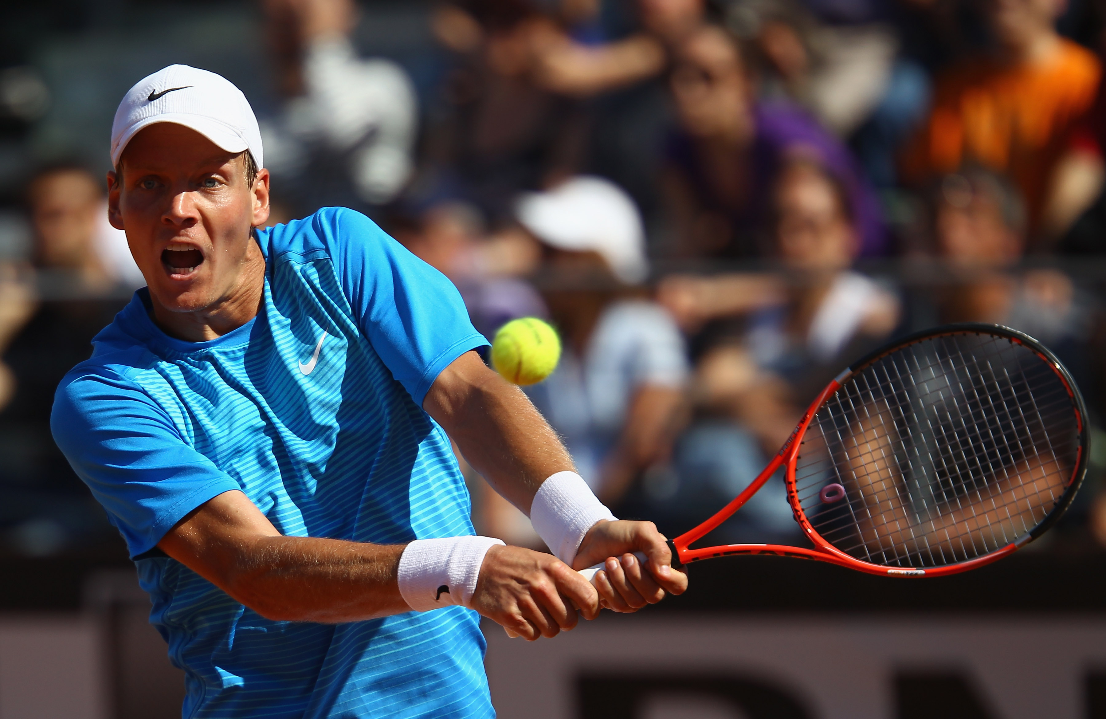 ROME, ITALY - MAY 10:  Tomas Berdych of Czech Republic plays a backhand during his second round match against Juan Monaco of Argentina during day three of the Internazoinali BNL D'Italia at the Foro Italico Tennis Centre on May 10, 2011 in Rome, Italy.  (