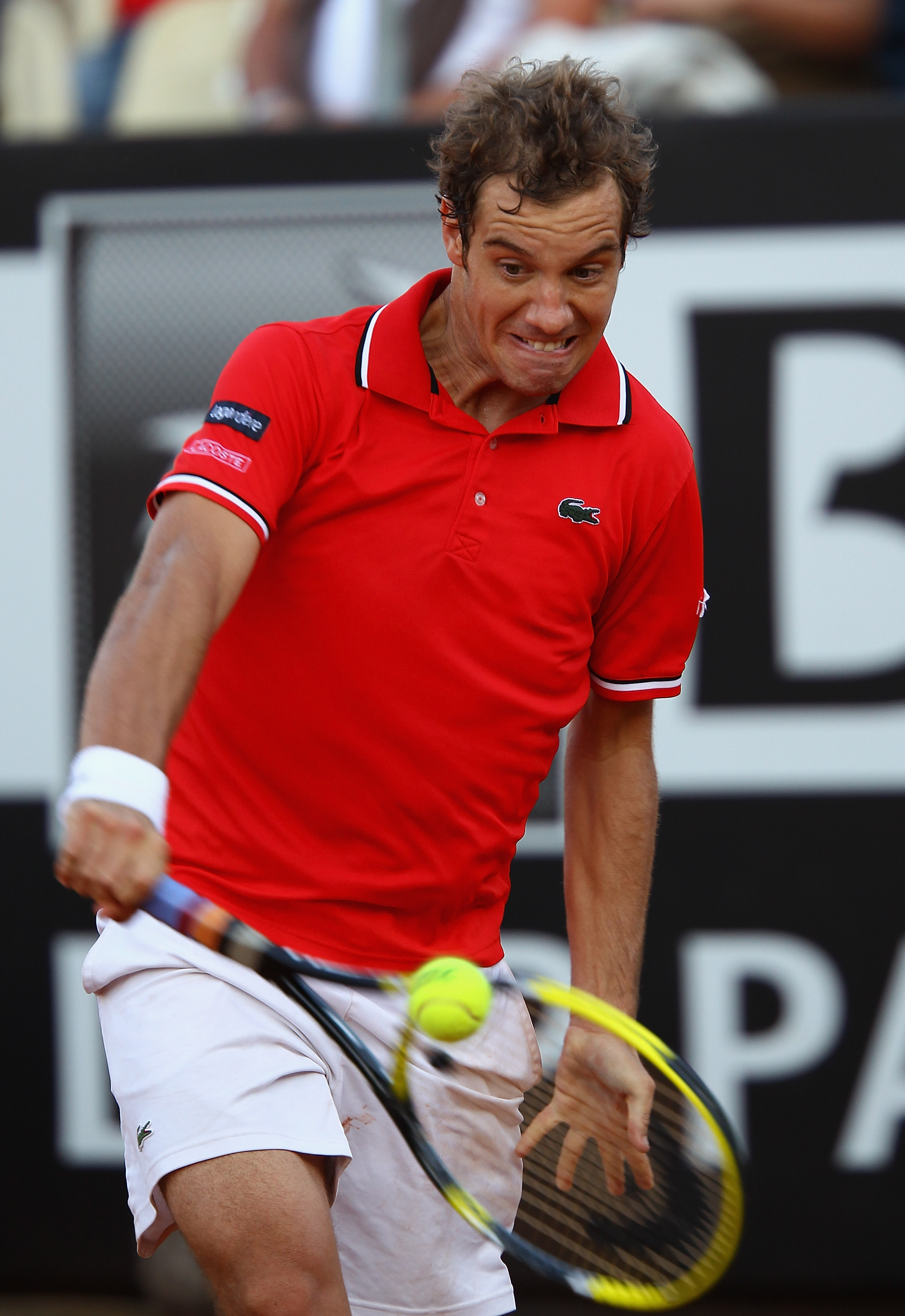 ROME, ITALY - MAY 13:  Richard Gasquet of France plays a backhand during his quarter final match against Tomas Berdych of Czech Republic during day six of the Internazoinali BNL D'Italia at the Foro Italico Tennis Centre  on May 13, 2011 in Rome, Italy.