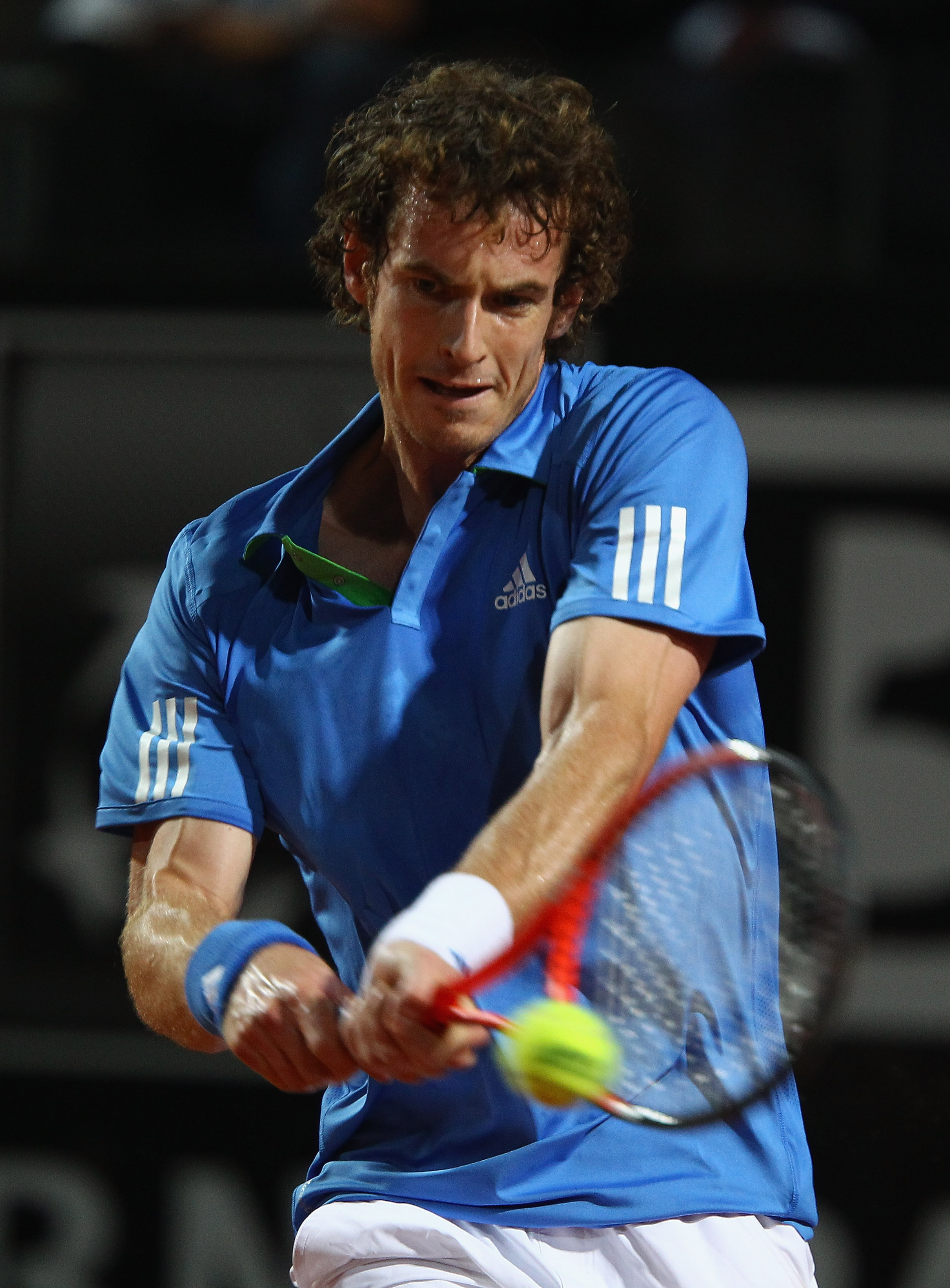 ROME, ITALY - MAY 10: Andy Murray of Great Britain plays a back hand during his second round match against Xavier Malisse of Belgium during day three of the Internazoinali BNL D'Italia at the Foro Italico Tennis Centre on May 10, 2011 in Rome, Italy.  (Ph