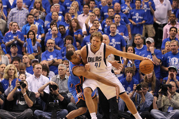 DALLAS, TX - MAY 17:  Dirk Nowitzki #41 of the Dallas Mavericks posts up Thabo Sefolosha #2 of the Oklahoma City Thunder in the second half in Game One of the Western Conference Finals during the 2011 NBA Playoffs at American Airlines Center on May 17, 20