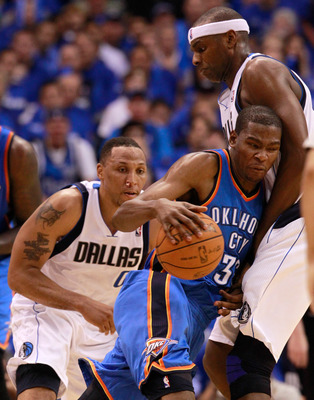 DALLAS, TX - MAY 17:  Kevin Durant #35 of the Oklahoma City Thunder moves the ball into Brendan Haywood #33 of the Dallas Mavericks as Shawn Marion #0 of the Mavericks is behind Durant in the second half in Game One of the Western Conference Finals during