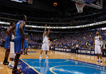 DALLAS, TX - MAY 17:  Dirk Nowitzki #41 of the Dallas Mavericks shoots a free throw late in the fourth quarter while taking on the Oklahoma City Thunder in Game One of the Western Conference Finals during the 2011 NBA Playoffs at American Airlines Center