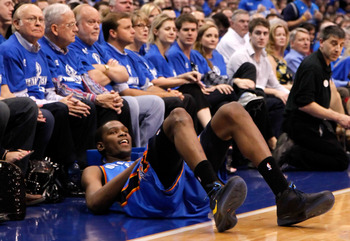 DALLAS, TX - MAY 17:  Kevin Durant #35 of the Oklahoma City Thunder reacts as he falls in front of the courtside seats in the first half while taking on the Dallas Mavericks in Game One of the Western Conference Finals during the 2011 NBA Playoffs at Amer
