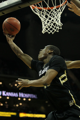 KANSAS CITY, MO - MARCH 10:  Alec Burks #10 of the Colorado Buffaloes shoots the ball against the Kansas State Wildcats during their quarterfinal game in the 2011 Phillips 66 Big 12 Men's Basketball Tournament at Sprint Center on March 10, 2011 in Kansas