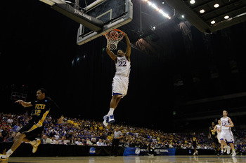 SAN ANTONIO, TX - MARCH 27:  Marcus Morris #22 of the Kansas Jayhawks dunks against the Virginia Commonwealth Rams during the southwest regional final of the 2011 NCAA men's basketball tournament at the Alamodome on March 27, 2011 in San Antonio, Texas.