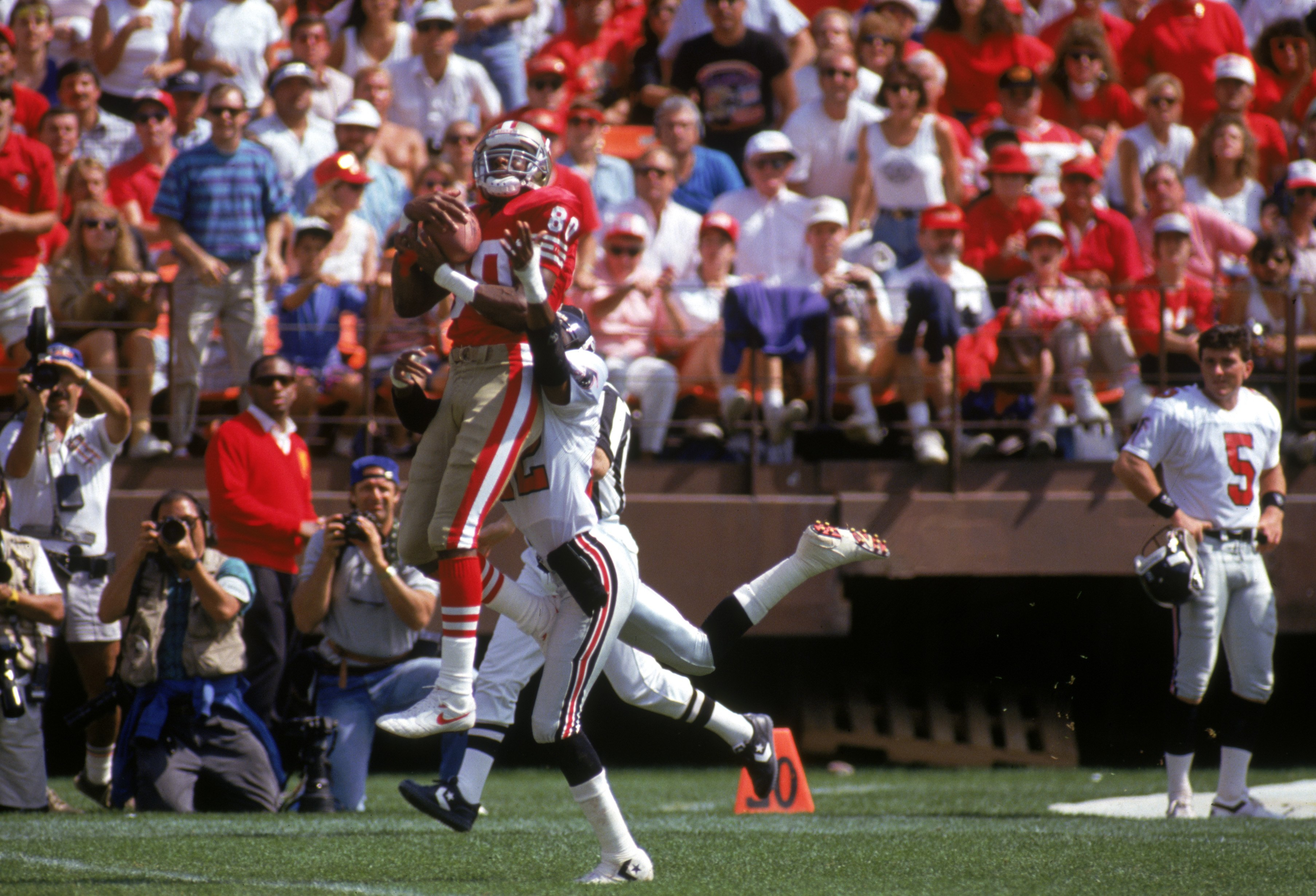 Jerry Rice Makes A Leaping Catch Over Charles Dimry