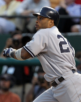ARLINGTON, TX - MAY 07:  Robinson Cano #24 of the New York Yankees hits a three run triple against the Texas Rangers in the third inning at Rangers Ballpark in Arlington on May 7, 2011 in Arlington, Texas.  (Photo by Ronald Martinez/Getty Images)