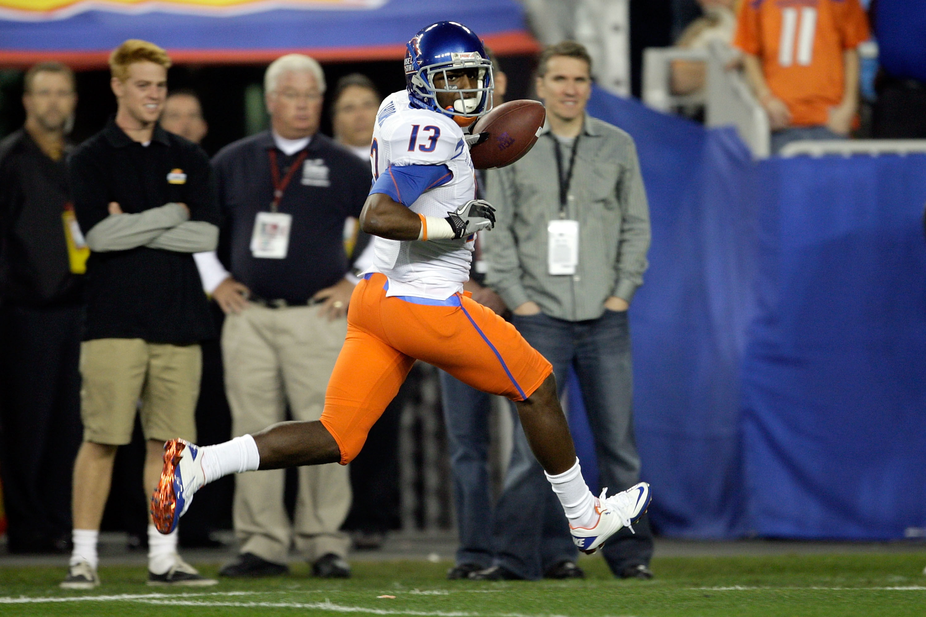 GLENDALE, AZ - JANUARY 04:  Brandyn Thompson #13 of the Boise State Broncos runs into the endzone after a 50-yard interception return for a touchdown in the first quarter against the TCU Horned Frogs during the Tostitos Fiesta Bowl at the Universtity of P