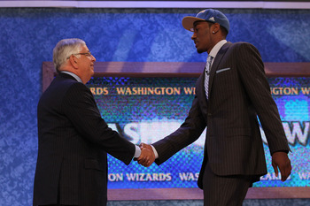 NEW YORK - JUNE 24:  John Wall of Kentucky stands with NBA Commisioner David Stern after being drafted with the first pick by the Washington Wizards at Madison Square Garden on June 24, 2010 in New York City.  NOTE TO USER: User expressly acknowledges and