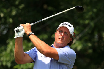 PONTE VEDRA BEACH, FL - MAY 13:  Phil Mickelson hits his tee shot on the fifth hole during the second round of THE PLAYERS Championship held at THE PLAYERS Stadium course at TPC Sawgrass on May 13, 2011 in Ponte Vedra Beach, Florida.  (Photo by Streeter L