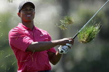 ORLANDO, FL - MARCH 18:  Tiger Woods of the USA hits his second shot at the par 4, 10th hole from the treacherous rough, during the final round of the Arnold Palmer Invitational presented by Mastercard, on the Championship Course at the Bay Hill Club and