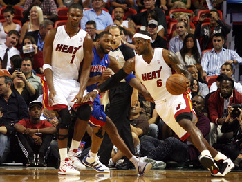 MIAMI - OCTOBER 05:  Center Chris Bosh #1 of the Miami Heat (L) sets a screen for teammate Lebron James #6 against the Detroit Pistons on October 5, 2010 in Miami, Florida.  NOTE TO USER: User expressly acknowledges and agrees that, by downloading and or