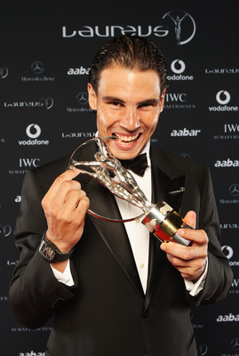 """ABU DHABI, UNITED ARAB EMIRATES - FEBRUARY 07:  Tennis Player Rafael Nadal of Spain poses with his award for """"Laureus World Sportsman of the Year"""" in the winners studio at the 2011 Laureus World Sports Awards at the Emirates Palace on February 7, 2011 in"""
