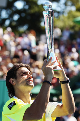AUCKLAND, NEW ZEALAND - JANUARY 15:  David Ferrer of Spain holds up the Heineken Open trophy after winning the Men's Final match against David Nalbandian of Argentina on day six of the Heineken Open at ASB Tennis Centre on January 15, 2011 in Auckland, Ne