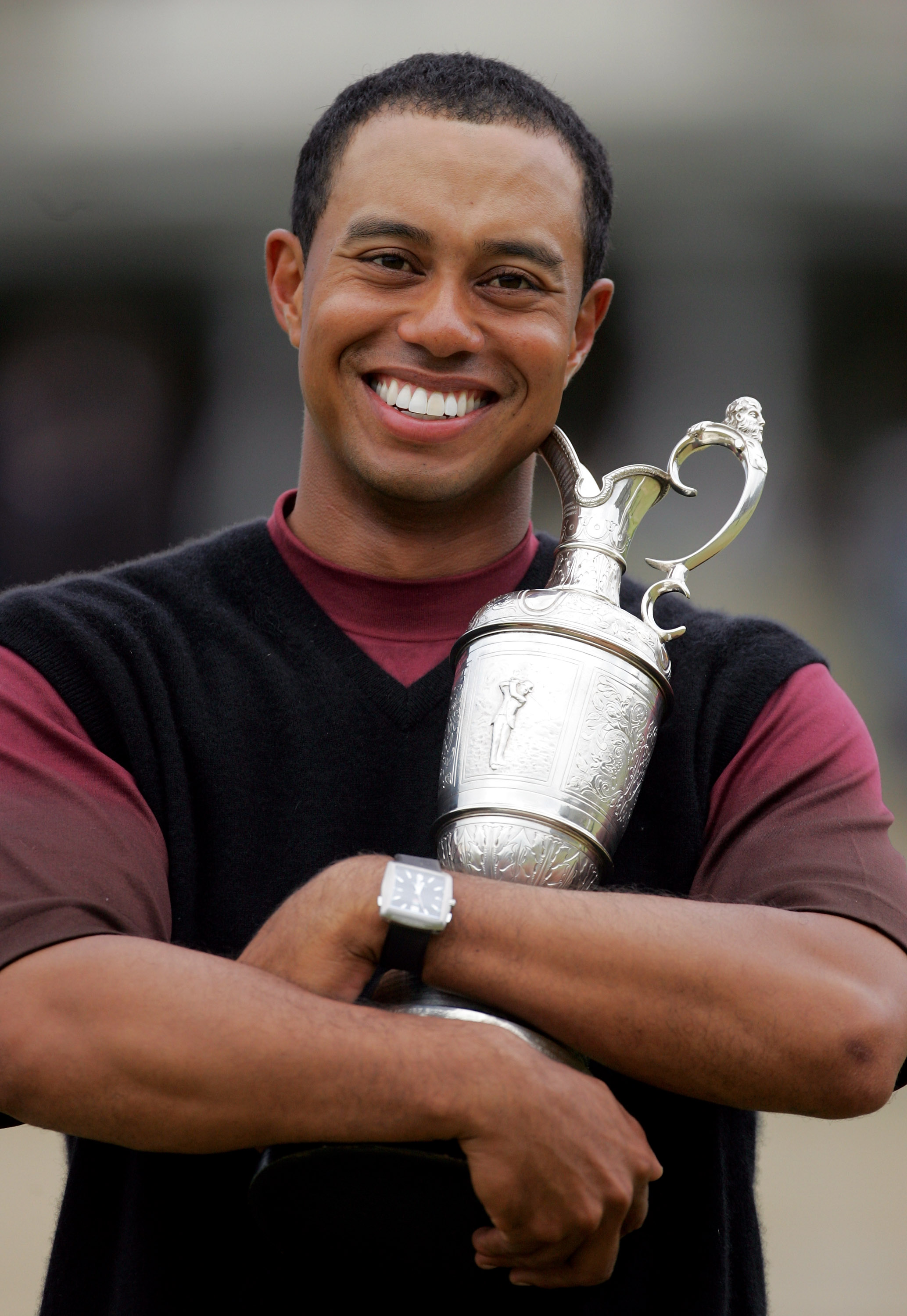 ST. ANDREWS, UNITED KINGDOM - JULY 17:  Tiger Woods of the USA hugs the Claret Jug after securing a five shot victory at the 134th Open Championship at Old Course, St Andrews Golf Links, July 17, 2005 in St Andrews, Scotland.  (Photo by Jamie Squire/Getty