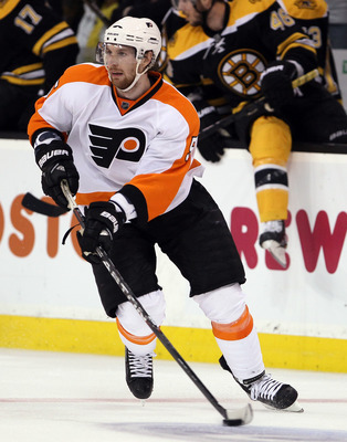 BOSTON, MA - MAY 06:  Braydon Coburn #5 of the Philadelphia Flyers passes the puck against the Boston Bruins in Game Four of the Eastern Conference Semifinals during the 2011 NHL Stanley Cup Playoffs at TD Garden on May 6, 2011 in Boston, Massachusetts. T