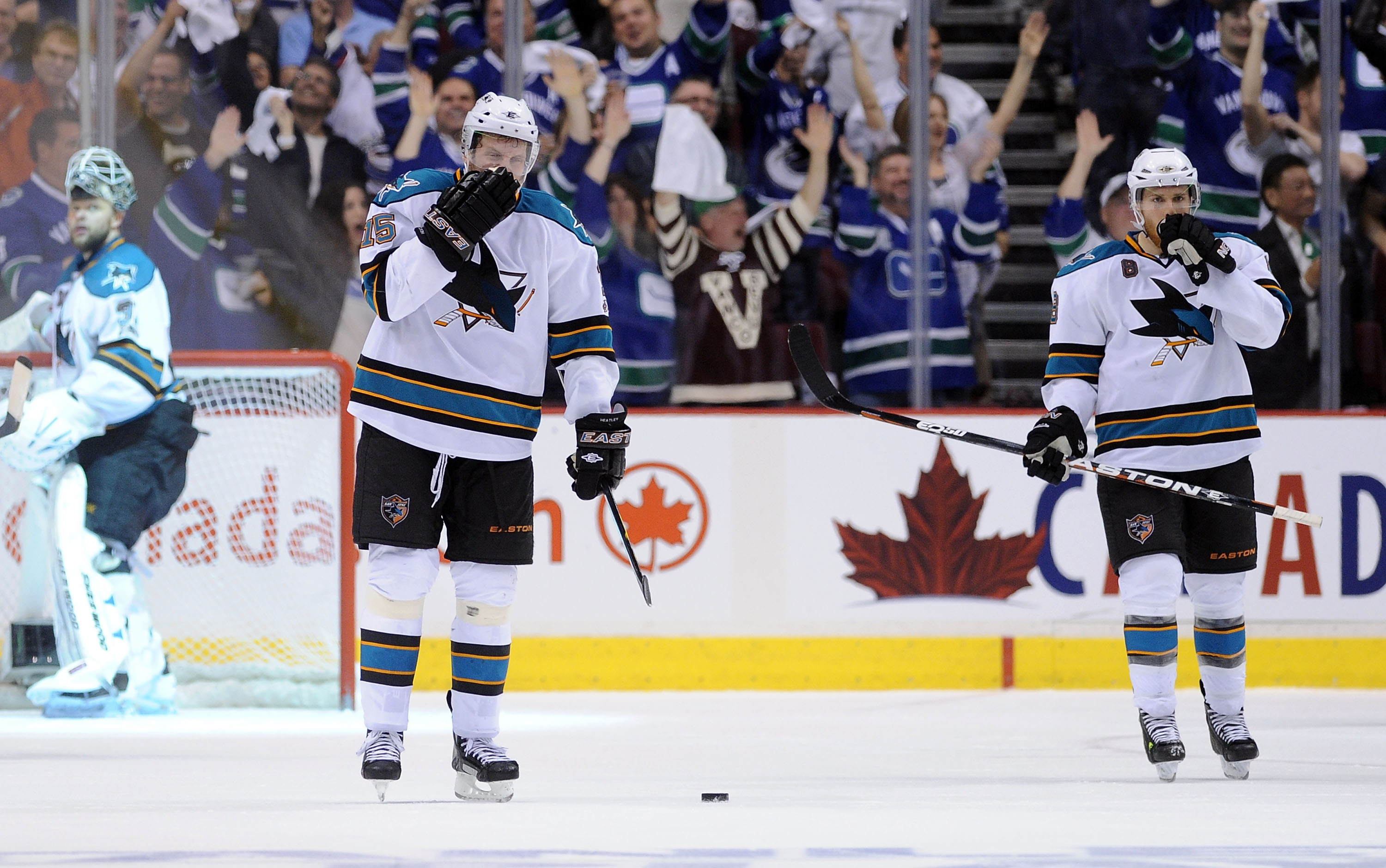 VANCOUVER, CANADA - MAY 18:  Antti Niemi #31, Dany Heatley #15 and Joe Pavelski #8 of the San Jose Sharks look on after a goal by Daniel Sedin #22 of the Vancouver Canucks in the third period in Game Two of the Western Conference Finals during the 2011 St