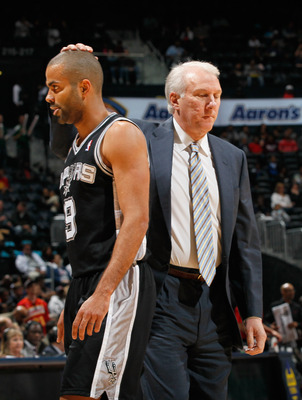 ATLANTA, GA - APRIL 05:  Tony Parker #9 and head coach Gregg Popovich of the San Antonio Spurs against the Atlanta Hawks at Philips Arena on April 5, 2011 in Atlanta, Georgia.  NOTE TO USER: User expressly acknowledges and agrees that, by downloading and/